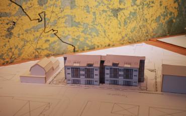 Bilden visar en modell på flerbostadshus