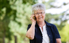 Senior woman having conversation on mobile phone