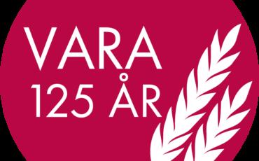 Bild med rund cirkel med texten Vara 125 år och två veteax.