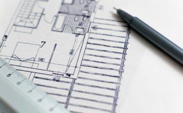 Bilden visar en ritning på en byggnad